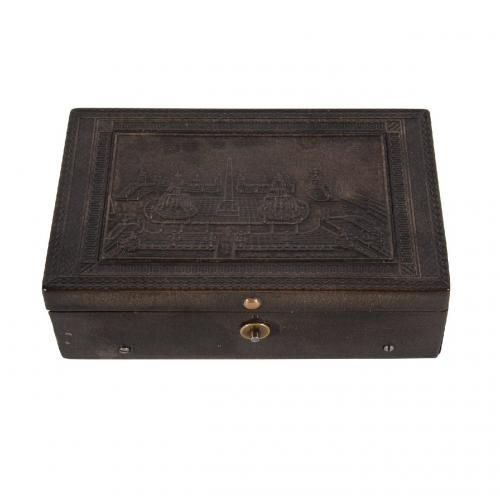 A finely engraved rectangular tortoiseshell music box
