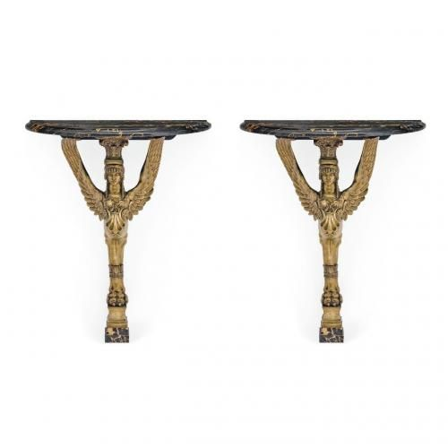 A pair of Empire style ormolu and marble console tables