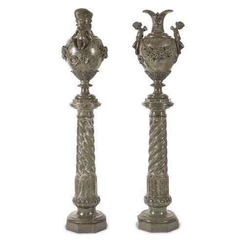 A fine pair of green marble vases on pedestals