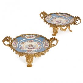 Pair of antique ormolu mounted porcelain decorative plates