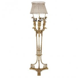 Ormolu, tole, porcelain and glass floor lamp with putti