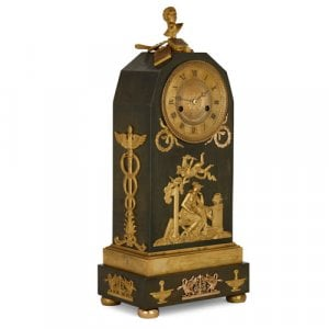 French Empire period gilt and patinated bronze mantel clock