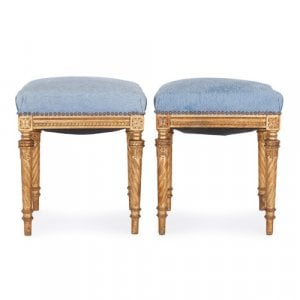 Two Louis XVI style upholstered carved giltwood stools