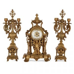 Antique French three-piece ormolu clock set