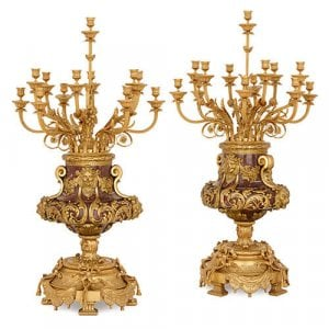 Pair of Louis XVI style ormolu and red marble candelabra