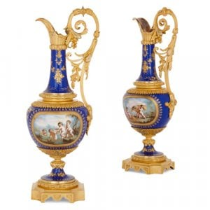 Pair of antique French ormolu and porcelain jugs