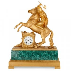 Charles X period ormolu and malachite mantel clock