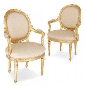 Pair of antique Louis XVI style giltwood armchairs