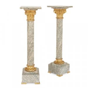 Pair of Neoclassical style ormolu mounted marble pedestals