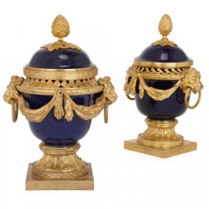 Two Neoclassical style ormolu and porcelain pot-pourri vases