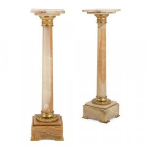 Pair of French ormolu mounted onyx column pedestals