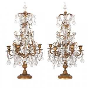 Pair of Louis XVI style six-light ormolu and glass candelabra