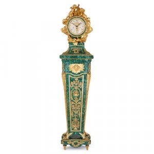 Ormolu mounted malachite pedestal clock after Riesener