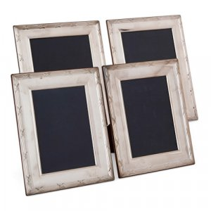 Set of four English Carrs silver photo frames