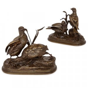 Pair of patinated bronze groups of birds by Moigniez
