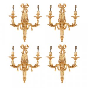 Set of four Louis XVI style ormolu twin light wall lights