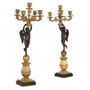 Two Empire period gilt and patinated bronze cherubim candelabra