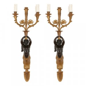 Pair of Empire style gilt and patinated bronze wall lights