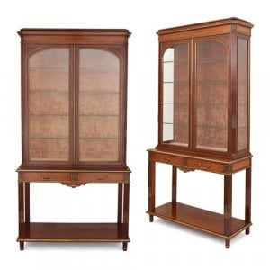 Pair of ormolu mounted metamorphic vitrine consoles