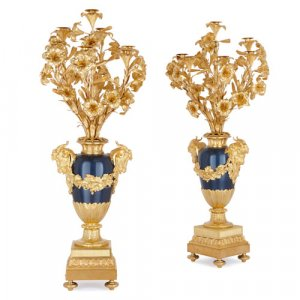 Two large Louis XVI style ormolu and painted metal candelabra