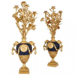 Pair of Louis XVI style ormolu and painted tole candelabra