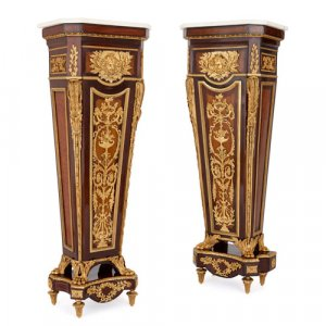 Two ormolu and marble mounted pedestals after Riesener