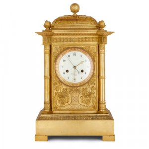 Large French Empire period ormolu mantel clock by Piolaine