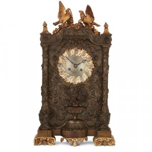 Antique gilt and patinated bronze mantel clock by Deniere