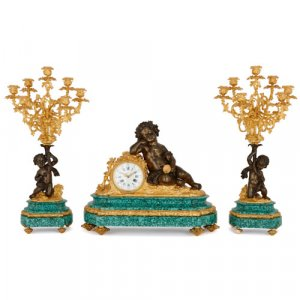 Louis XVI style gilt and patinated bronze malachite clock set