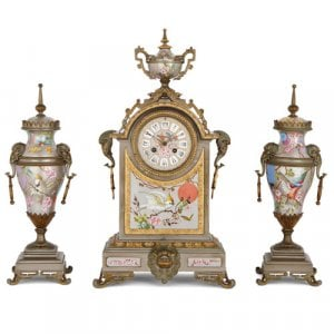 Antique porcelain, silvered and parcel gilt brass clock set