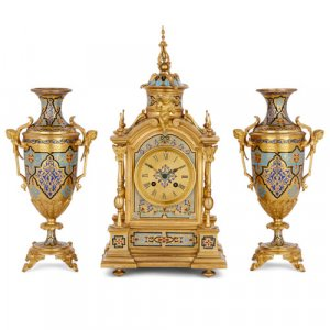 Renaissance Revival style ormolu and champlevé enamel clock set