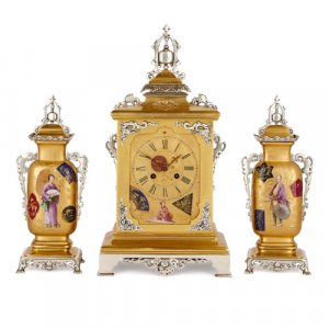 Japonisme porcelain, silvered and gilt brass clock set