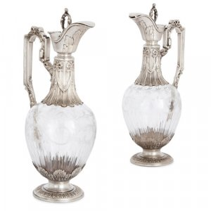 Pair of antique French silver and glass claret jugs by Gross