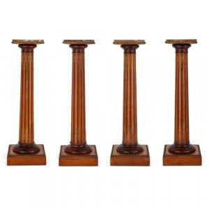 Set of four satinwood, marble, and ormolu pedestals
