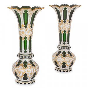 Pair of Bohemian parcel gilt white overlay green vases