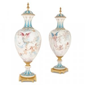 Pair of large Sèvres style white porcelain and ormolu vases