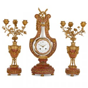 A Louis XVI style ormolu and marble three piece clock set
