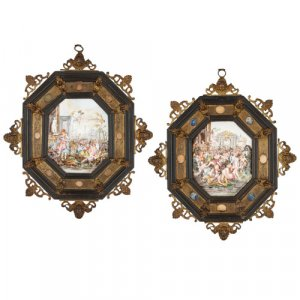 Pair of framed Capodimonte porcelain relief plaques