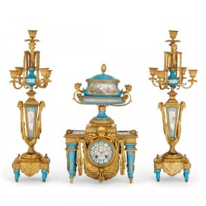 Sèvres style jewelled porcelain and ormolu three-piece clock set