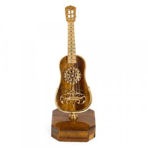 Silver-gilt mounted tiger's eye miniature guitar