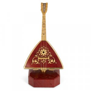 Silver-gilt mounted red jasper miniature balalaika