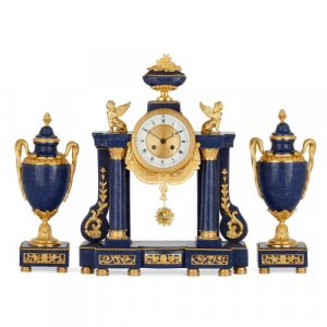 Gilt bronze and lapis lazuli three piece clock garniture