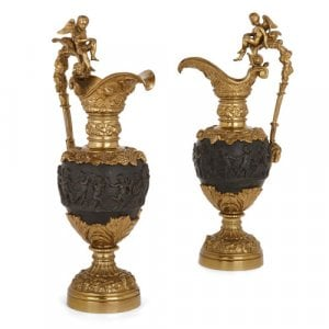 Pair of gilt and patinated bronze ewer-form vases