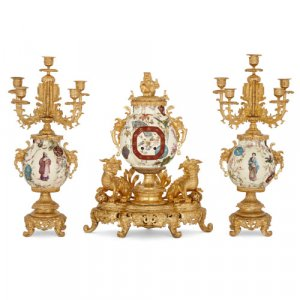 Chinoiserie style ormolu and faience three-piece clock set