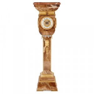Ormolu and champlevé enamel mounted red onyx pedestal clock