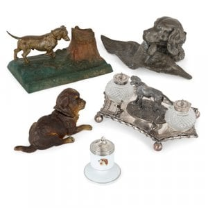 Collection of five dog-themed inkwells
