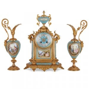 Sèvres style porcelain and ormolu three-piece clock set