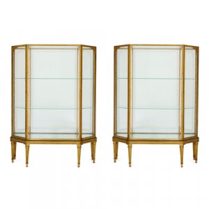 Pair of French gilt-metal, giltwood, and glass vitrines