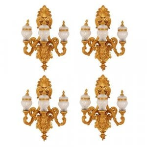 Set of four ormolu and glass three-light wall lights