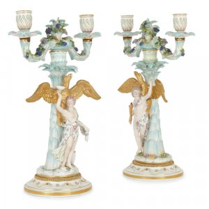 Pair of antique Meissen parcel-gilt porcelain candelabra